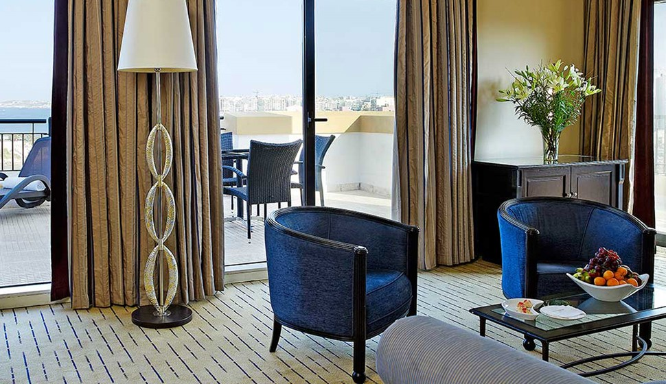 Corinthia St George's bay deluxe suite living room