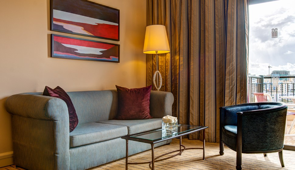 Corinthia St George's bay junior suite living room