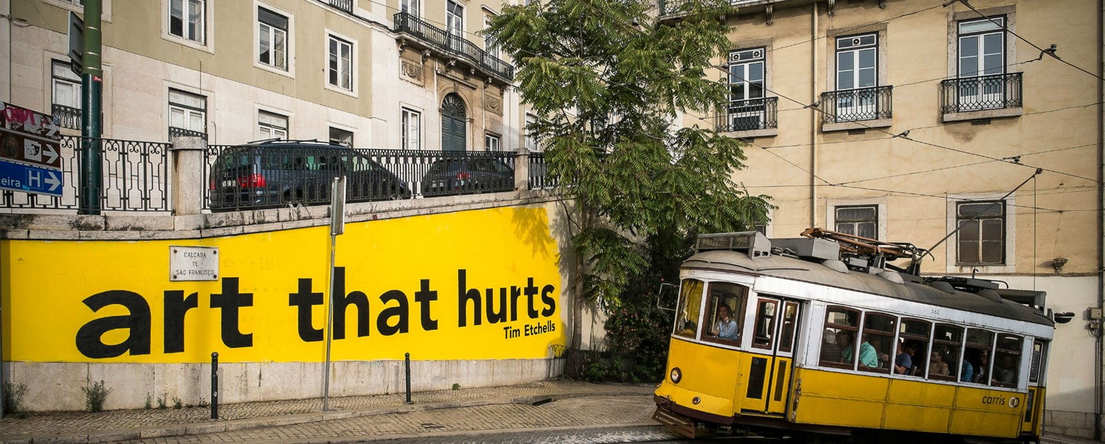 Street art reading 'that hurts' by Tim Etchells