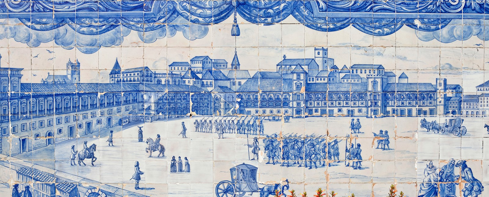 An azulejo mural of soldiers in a town square