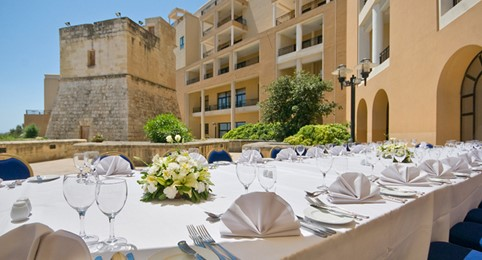 Corinthia St George's Bay tables exterior