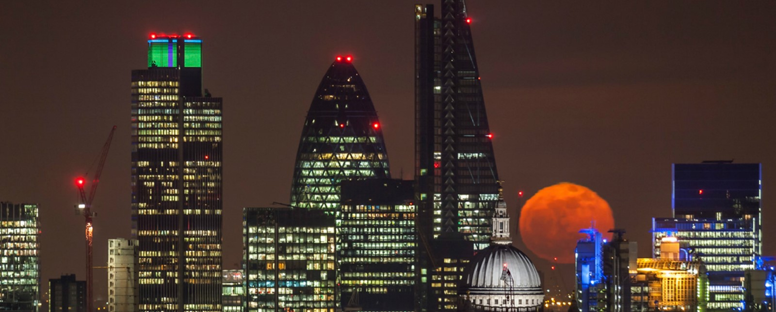 London skyline on a night with a blood moon