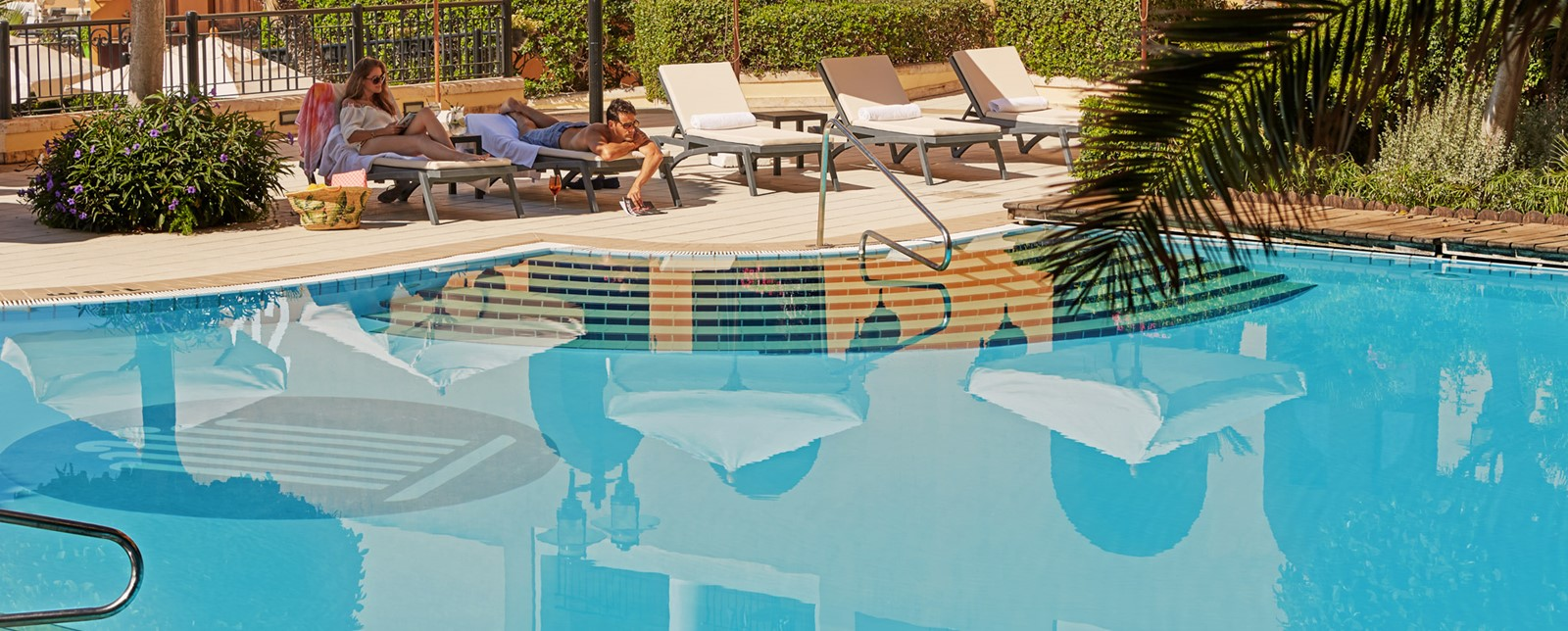 Corinthia St George's Bay Pool loungers