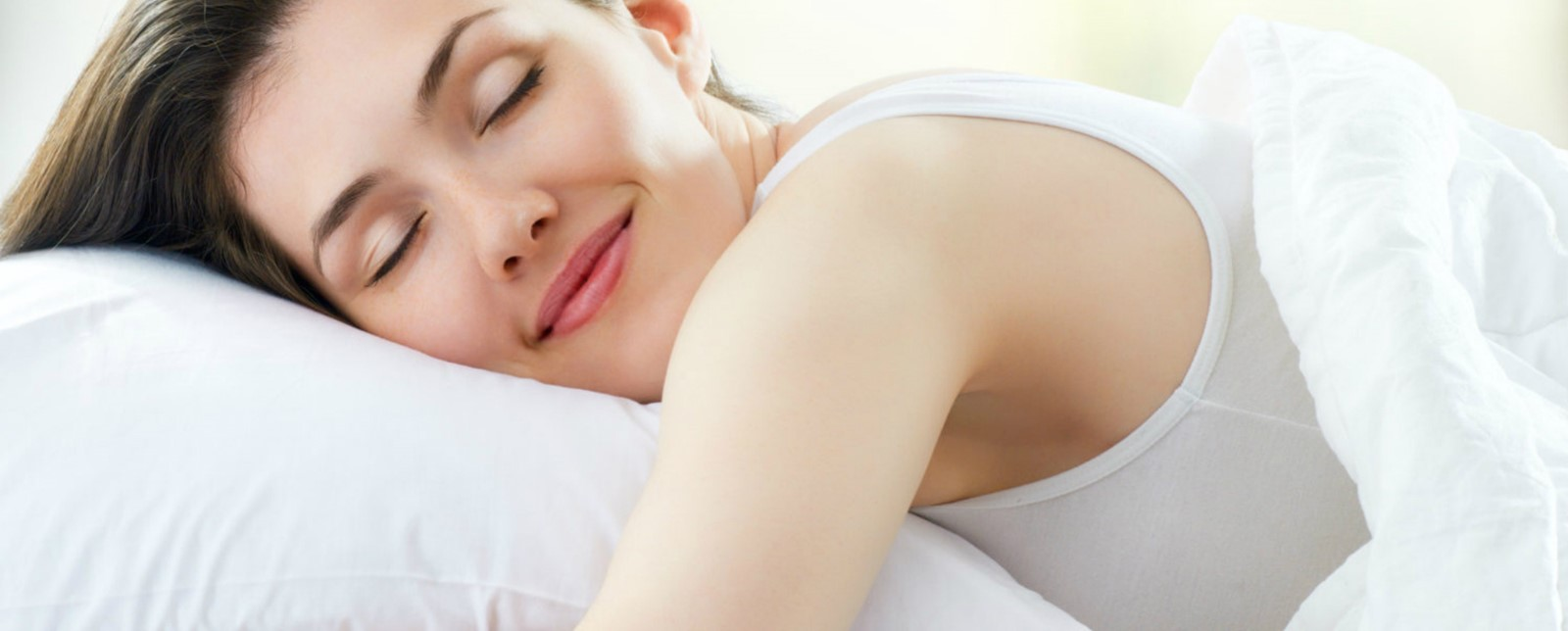 A woman sleeping and smiling
