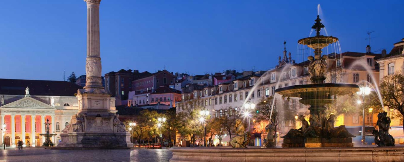 A patterned floored square in Lisbon with a fountain