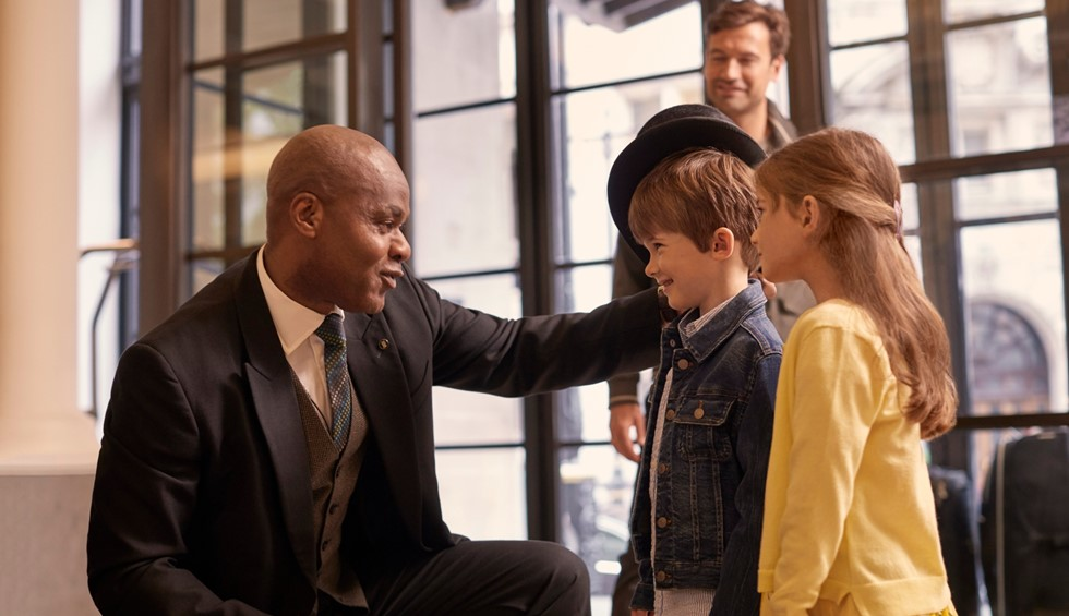 corinthia doorman with children