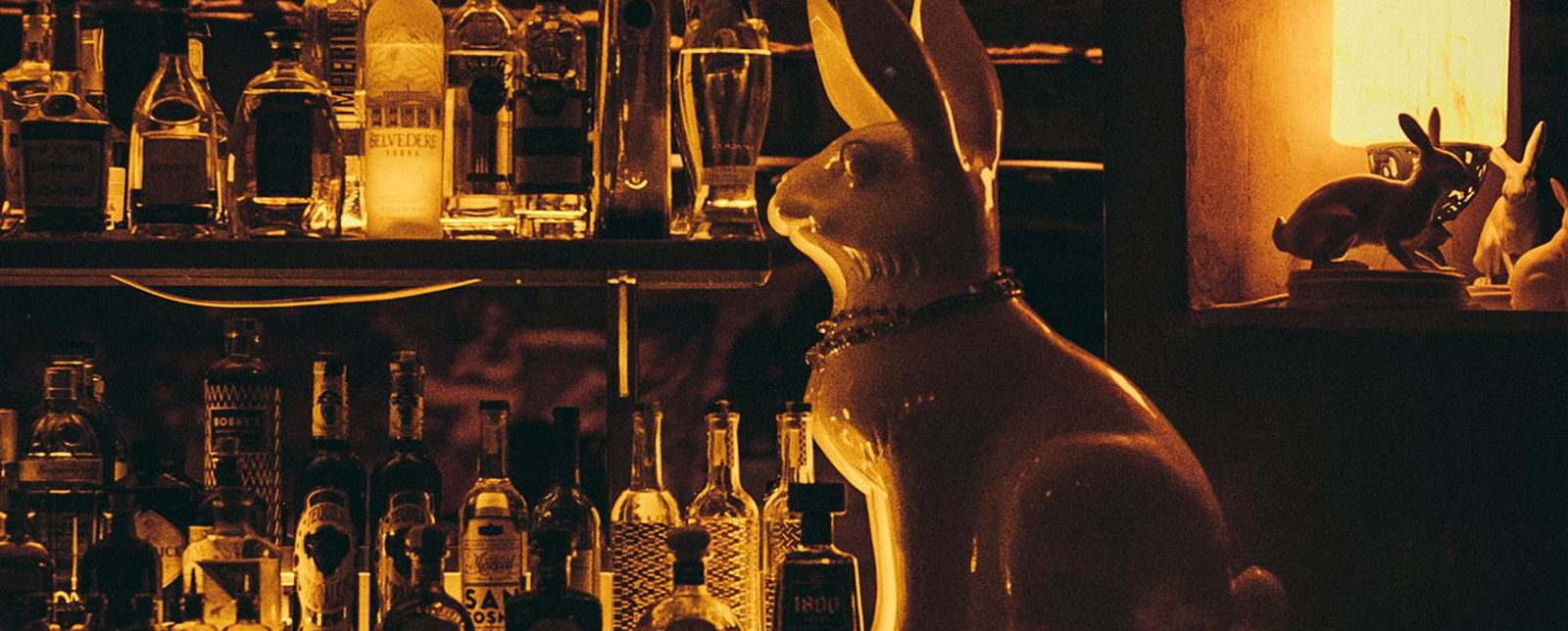 Rabbit statue and spirit bottles at Her Majesty the Rabbit bar